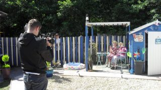 Cartref Annwyl Fan residents star in ITV News coverage for their beach inspired garden