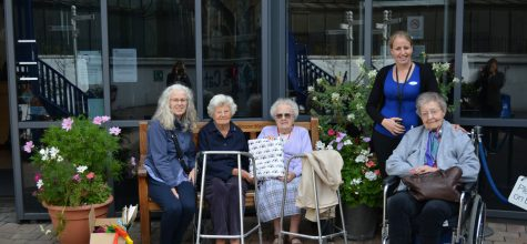 Kew House residents donate knitted blanket to Battersea Dogs & Cats Home