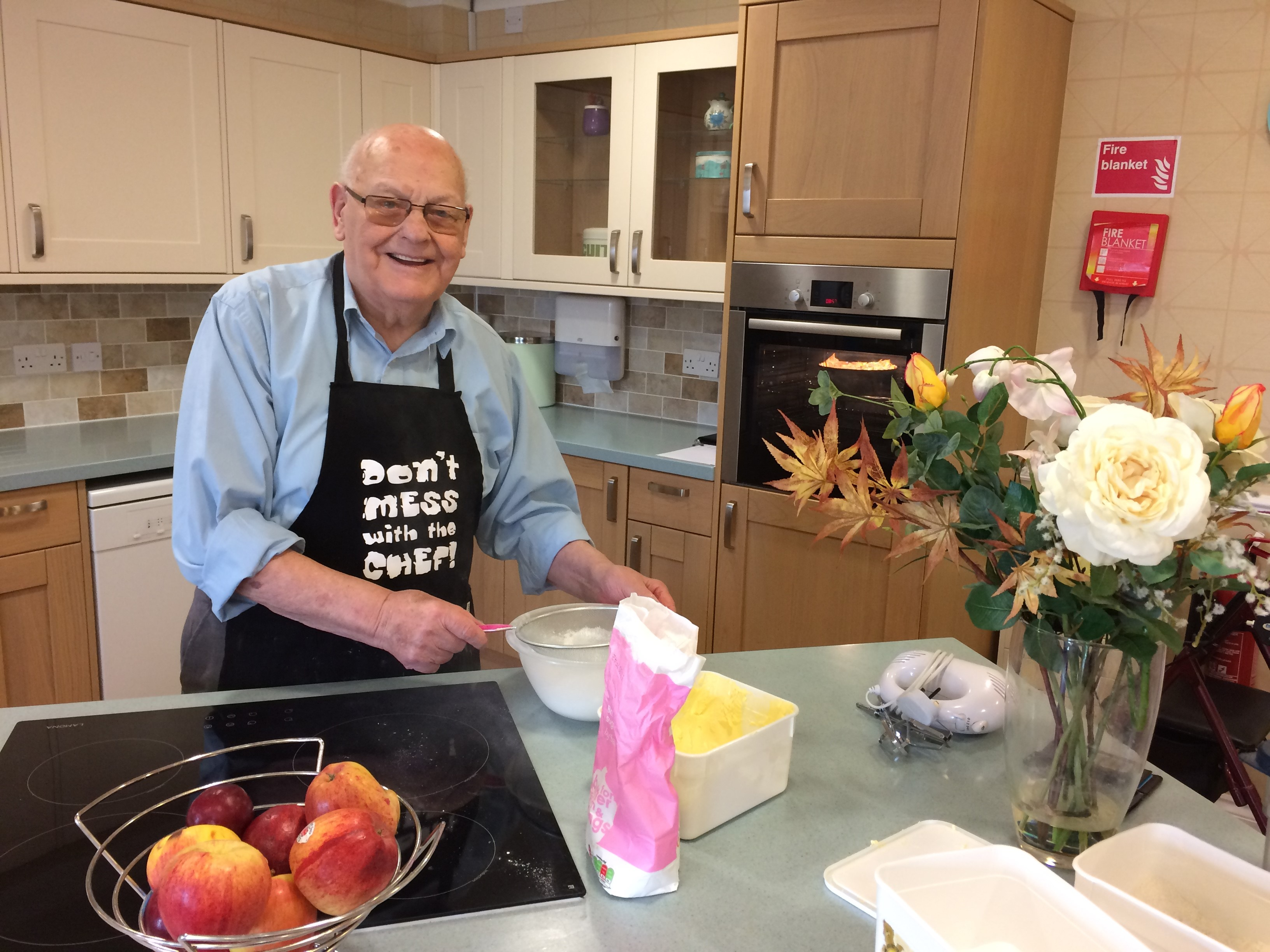 John Sprakes, 90, a resident at Kew House Care Home cooking Sausage Rolls