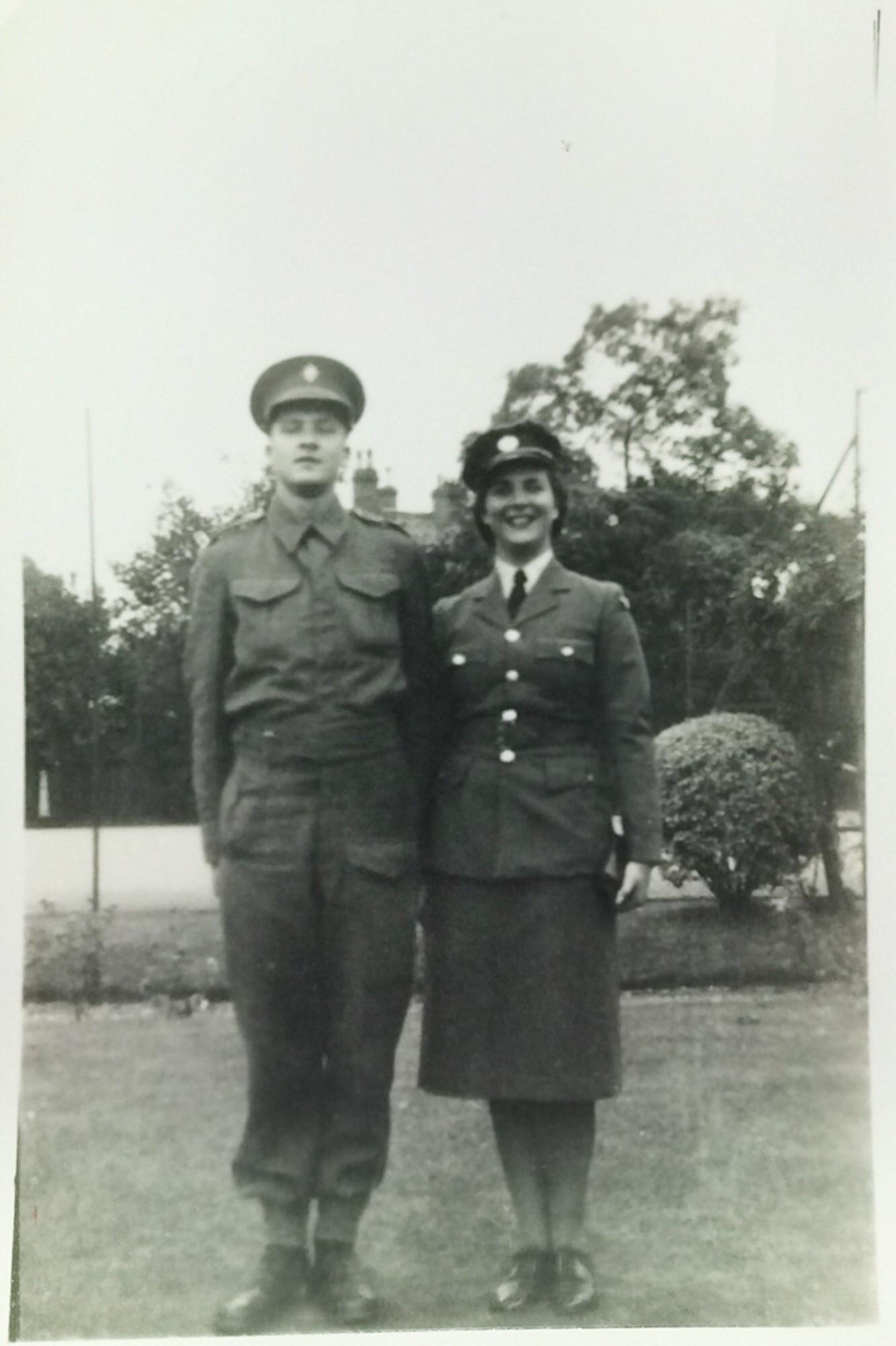 Ann and a colleague in their uniform