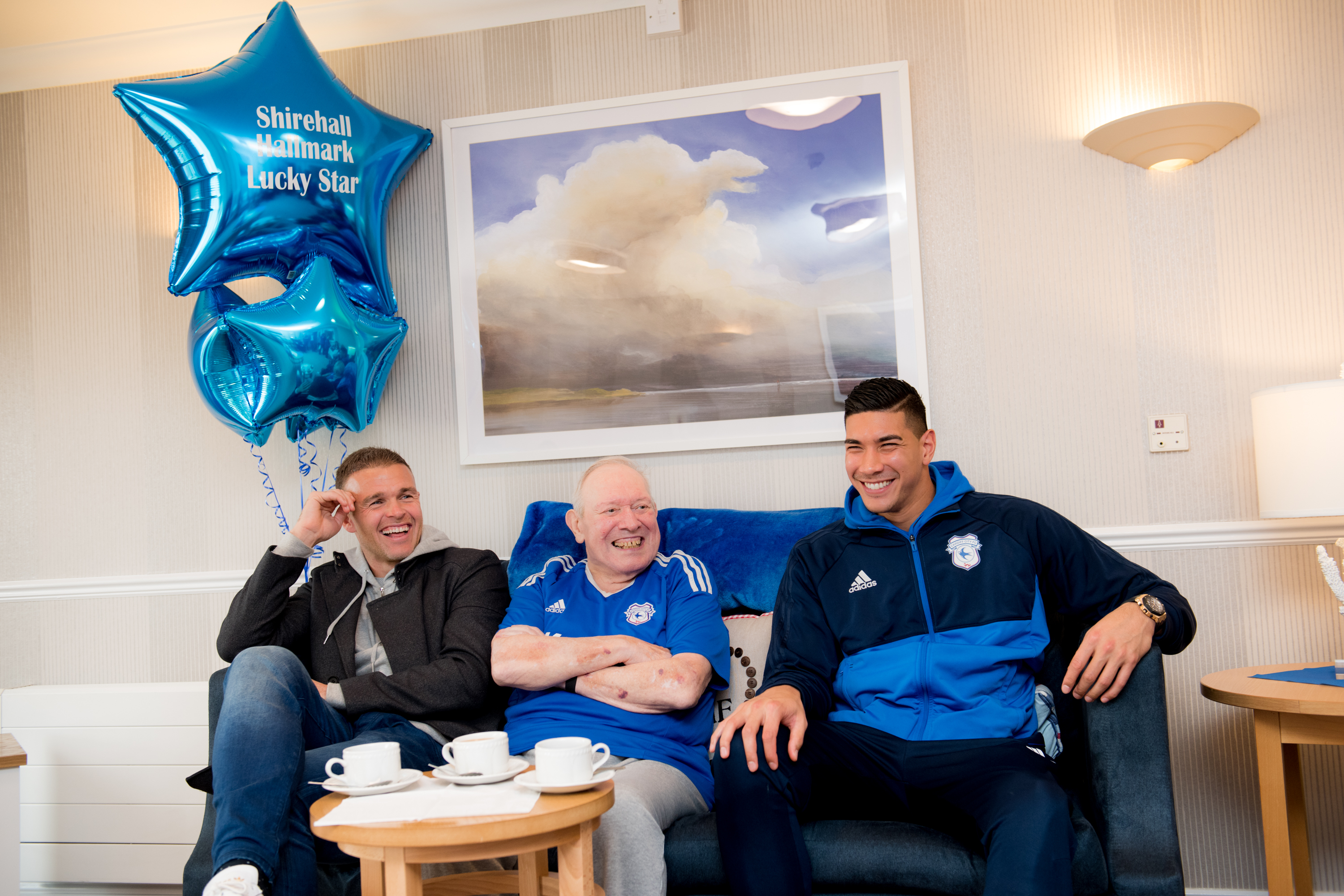 Denis Hazlewood, 83 with Cardiff City FC  players Brian Murphy and Neil Etheridge at our care home