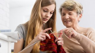 Residents, relatives and team get knitting for The Great Hallmark Scarf-athon
