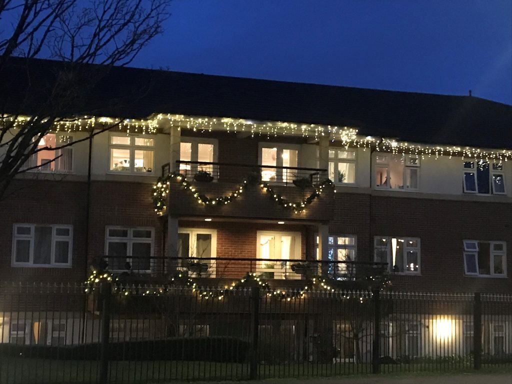 Ty Enfys Care Home lifts spirits with Christmas light switch on