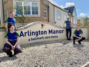 Team members standing outside Arlington Manor